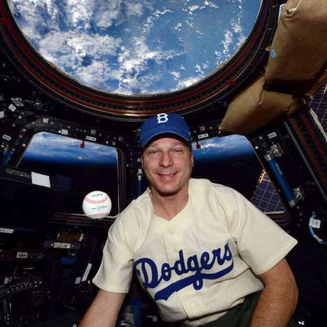 Astronaut Terry Virts wears Jackie Robinson's Brooklyn Dodgers uniform in space