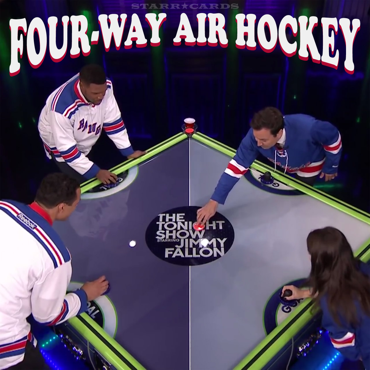Jimmy Fallon, Eve Hewson, Michael Strahan and Tony Gonzalez play four-way air hockey
