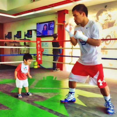 Manny Pacquiao in the ring with his toddler son