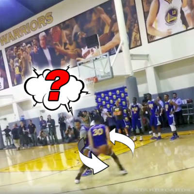 Steph Curry goes behind the back before sinking three point shot