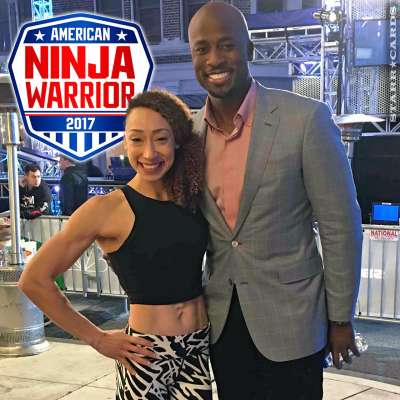 Zhanique Lovett poses with Akbar Gbaja-Biamila on set of 'American Ninja Warrior'
